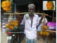 காவடி ஏந்தி வருவதுபோல் அயனிப்பழம் விற்பனை செய்யும் அழகைப்பாருங்க மக்கா!